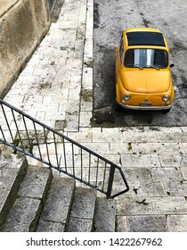 Ragusa Italy - February 27 2018: A yellow Fiat 500 parked