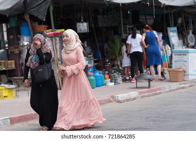 Rahat,Israel - September 23,2017.Young Arab women  in Arab dress on the street of bedouin city Rahat . Is the largest Bedouin city in the world, and the only one in Israel to have city status.