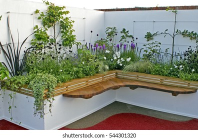 Raided flower bed and seating in a urban garden