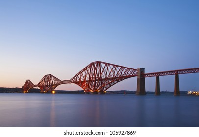Rail Bridge over The Firth of Forth, crossing between Fife and Edinburgh at dusk, Scotland. Night scene