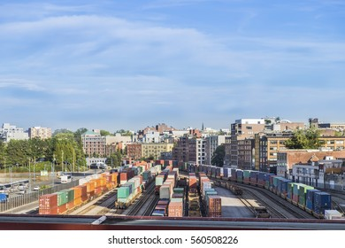Rail cars loaded with containers wait at the waterfront rail yard in Vancouver British Columbia Canada.
