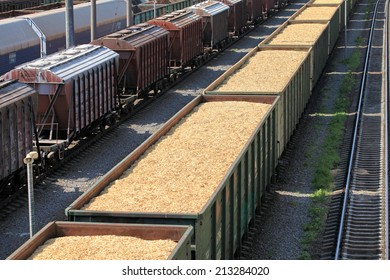 rail cars loaded with wood chip