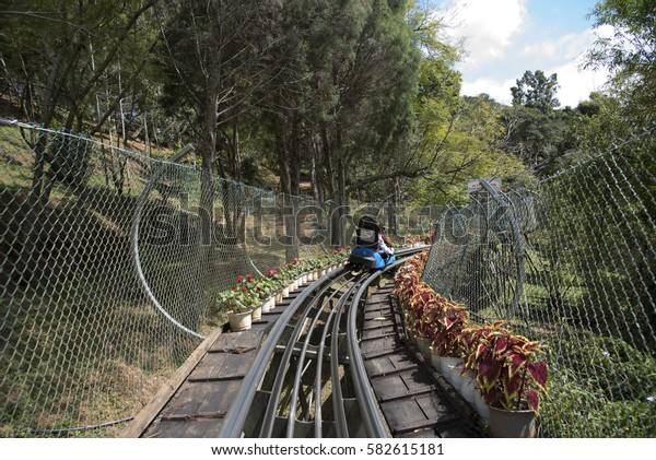 Rail downhill on a trolley to the Datanla waterfall in Vietnam