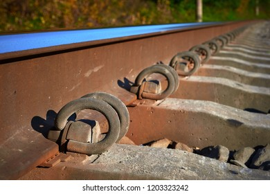 rail fastening to sleepers