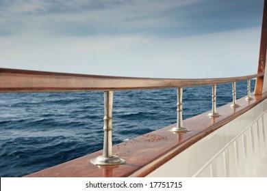 Rail of Pleasure boat sailing the Aegean sea