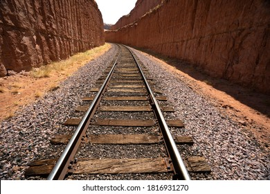 Rail road track cut through solid rock in the Utah mountains.