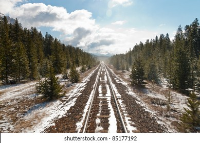 Rail tracks in Canada with snow and trees