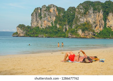 Railay Beach, Krabi, Thailand, 1st January 2019: Morning scene with long tail boats and tourists at lovely Railay beach.
