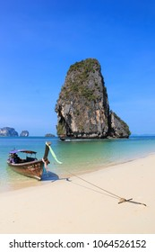 RAILAY BEACH, KRABI, THAILAND  APRIL 8 2015 Traditional Wooden Longtail Boat anchored on Railay Beach in Krabi Province Southern Thailand,