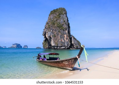 RAILAY BEACH, KRABI, THAILAND  APRIL 8 2015 Traditional Wooden Longtail Boat anchored on Railay Beach in Krabi Province Southern Thailand