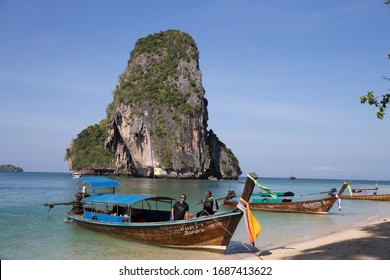 RAILAY BEACH, KRABI, THAILAND -  MARCH 3, 2018: Wooden Thai boats moored after bringing tourists to Railay beach near Krabi in southern Thailand.