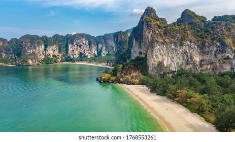 Railay beach in Thailand, Krabi province, aerial bird's view of tropical Railay and Pranang beaches with rocks and palm trees, coastline of Andaman sea from above
