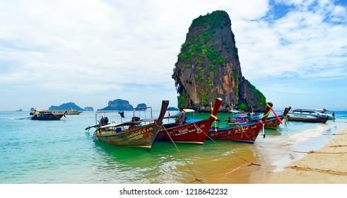 Railay, Krabi province, Thailand, April 28, 2015 - Long tail boats mooring at Phra Nang beach.