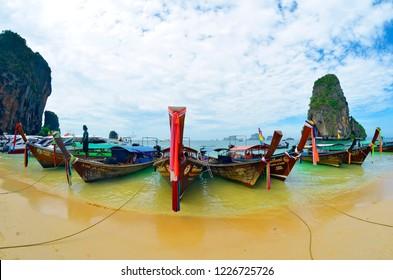 Railay, Krabi province, Thailand, April 28, 2015 - Wide angle view of long tail boats mooring at Phra Nang beach.