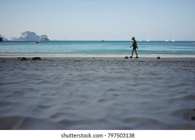 Railay, Krabi, Thailand - Dec 20, 2017. Railay West Beach at morning. The tourist is walking on the beach.