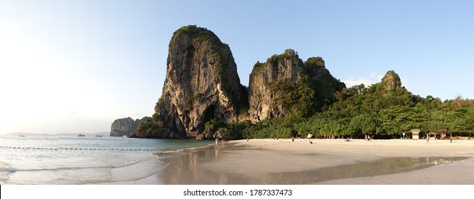Railay / Thailand - February 2017: Tourists at Phra Nang Beach with rocky peaks in the ocean at Railay, Thailand.