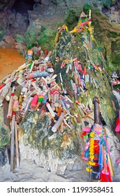 Railay, Thailand, October 24, 2014 - Phallus shaped figurines and floral garlands at Phra Nang Princess Cave.