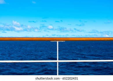 Railing of cruise ship in front of seascape