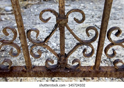 A railing eaten away with rust