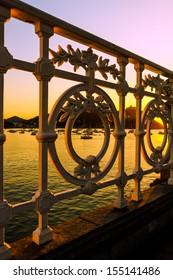 Railing of la Concha of San Sebastian in sunset