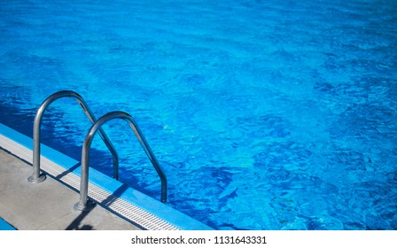 railing on the pool in the summer
