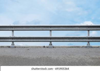 railing at road side on blue sky background