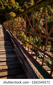 The railing of a rusty old bridge