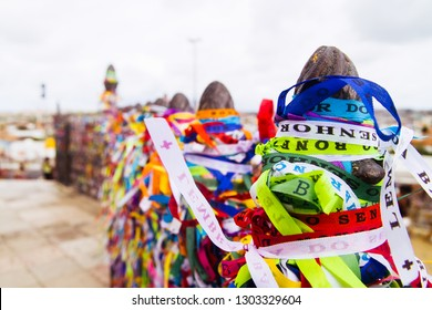 The railings of the Church of Senhor do Bonfim in Salvador, Brazil, adorned with wish ribbons left during the Festa do Bonfim celebrations.