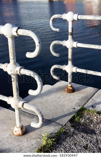 railings near water on port