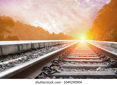 Railroad with beautiful sky sunset. Industrial landscape with railway station, colorful twilight sky, yellow sunlight. move forward to gold, reach to the sky concept.