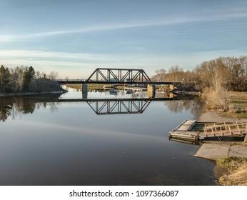 A railroad bridge over a river in Saguenay, Quebec