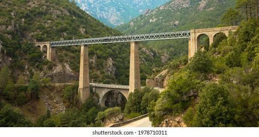 Railroad bridge Pont du Vecchio, designed by architect Gustave Eiffel near Vivaro, Corsica, France.