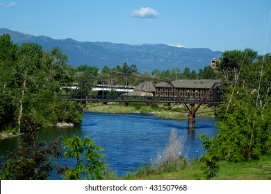A railroad bridge spans the Clark Fork River in Missoula, Montana.
