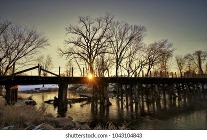 Railroad bridge at sunrise