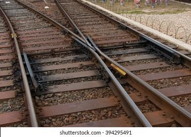 Railroad crossing, railway tracks at Arashiyama Station, Kyoto, Japan.