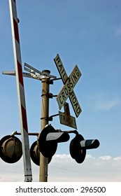 Railroad Crossing sign, lights and barrier
