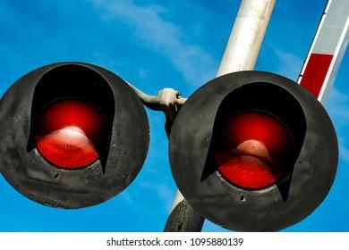 railroad crossing signal lights against a blue sky