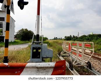 "Railroad crossings, Railroad Barrier, traffic signs of Thai wording ""Stop"""
