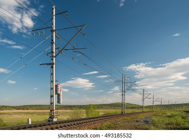 railroad and electric wires in perspective