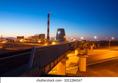 railroad to power plant. power plant at night.