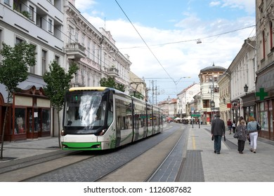 The railroad of public transport - modern tram - crosses the pedestrian center of the historical Miskolc city - a famous Spa resort in the Eastern Hungary