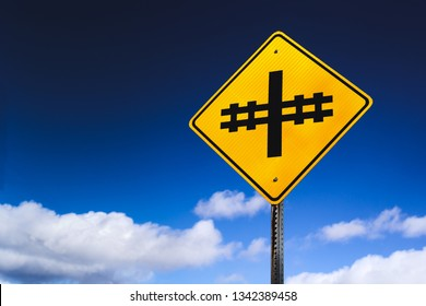 Railroad or railway crossing sign and sky with copy space.