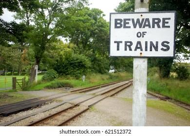 Railroad sign. Beware of Trains. Rail traffic signs. Rail crossing signs. Railroad safety notification symbol. Isle of Man rail station. Passive lifesaver signs. Lifesaver symbol Warning railroad sign
