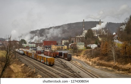 A railroad in a small town with a paper mill.