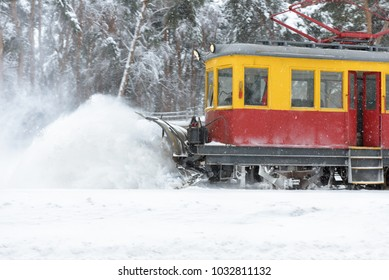 Railroad snow removal equipment during a snowstorm. Cleaning of tram tracks in winter, Moscow, Russia. Snowplow on the street. - Shutterstock ID 1032811132