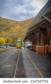 Railroad Station with train entering on a cloudy and stormy fall day