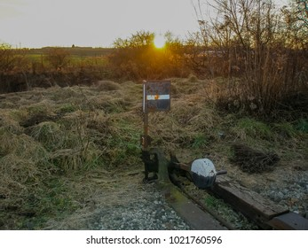 Railroad switch in sunset