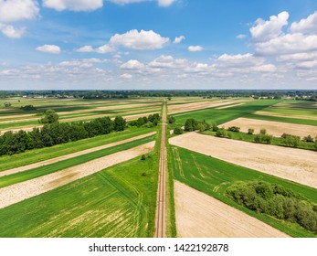 Railroad track amongst rural area aerial view