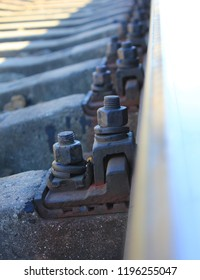Railroad Track with Concrete Sleepers and Metal Rails Close Up View. Details of Train Track and Industrial Iron Sleeper Elements. Commuter Transportation Pathway, Railway Close Up View