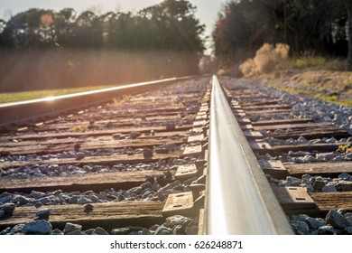 Railroad track during sunset